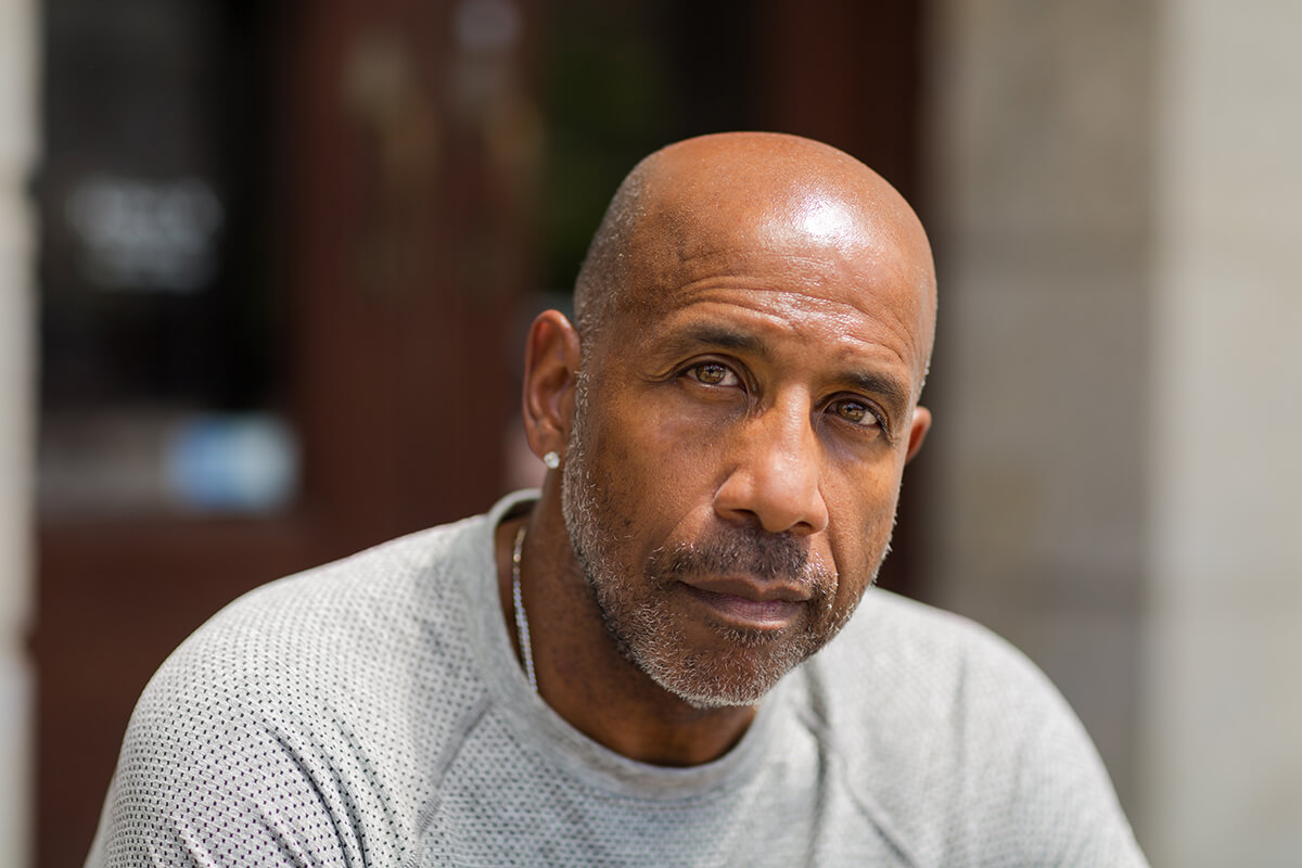 black man with earring seeing signs of heroin use
