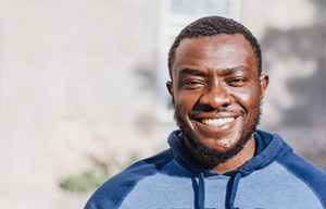 african american man outside smiling after dialectical behavior therapy