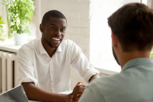 man meeting with intake specialist at inpatient rehab program